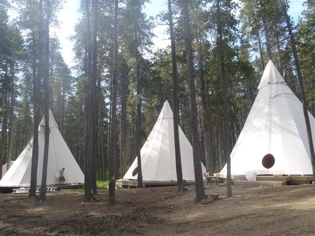 image-of-3-tipis-with-rain-caps